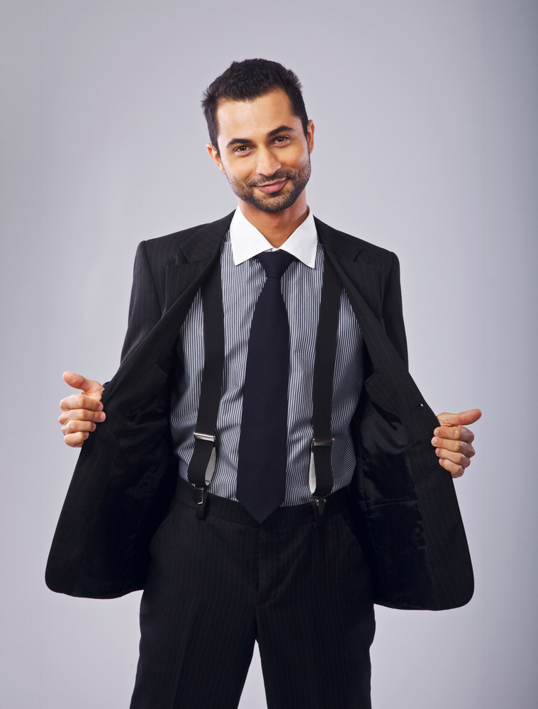 Cheerful Young Professional Holding Open His Coat