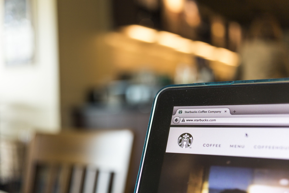 CHIANG MAI, THAILAND - OCTOBER 02, 2014: Photo of Starbucks Coffee Company homepage on a Apple macbook pro.