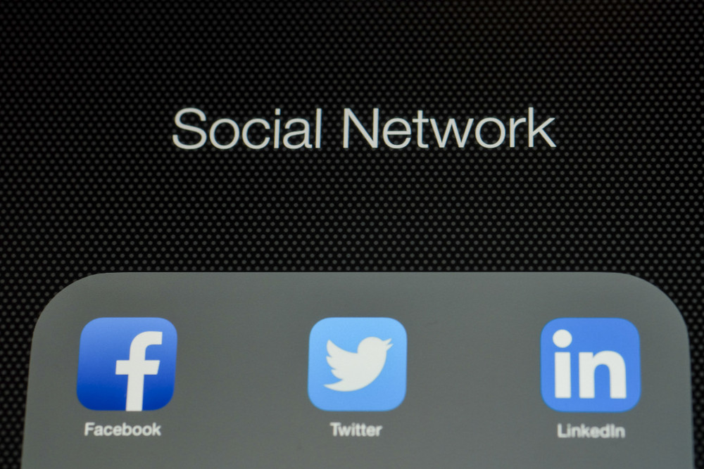 CHIANG MAI, THAILAND - OCTOBER 03, 2014: All of popular social media icons on Apple ipad Air device screen.