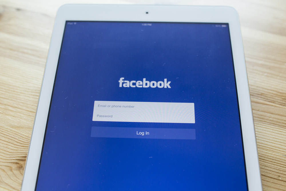 CHIANG MAI, THAILAND - SEPTEMBER 07, 2014: Facebook application sign in page on Apple iPad Air. Facebook is largest and most popular social networking site in the world.