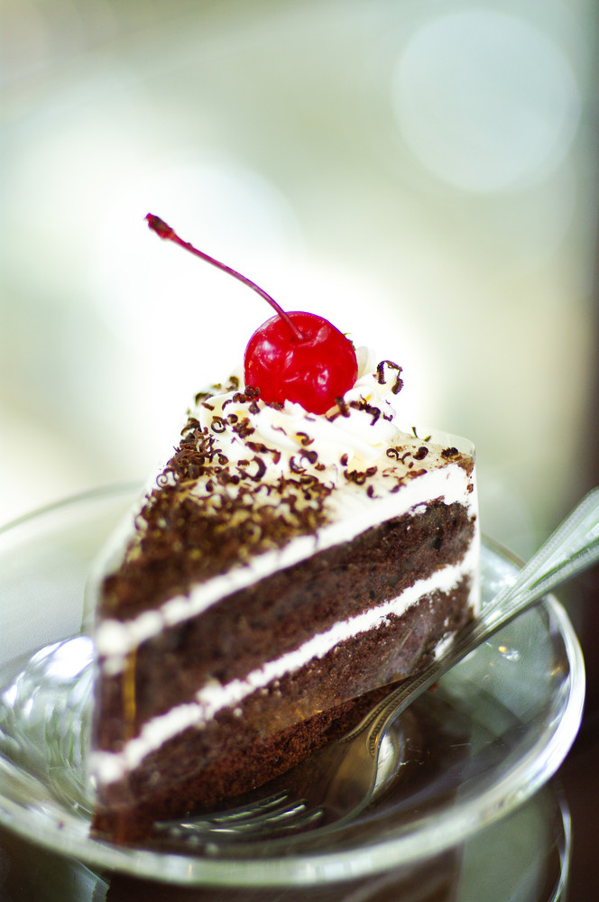 Chocolate cake with red cherry on top