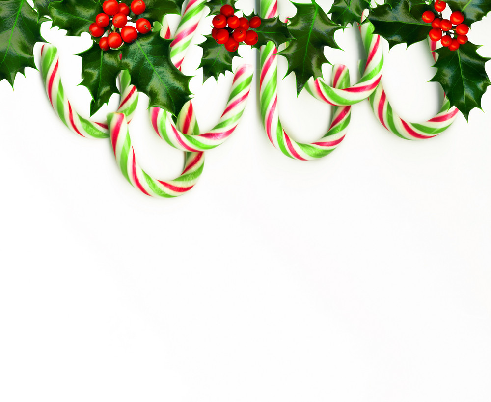 Christmas Border With Candy Canes Isolated On White