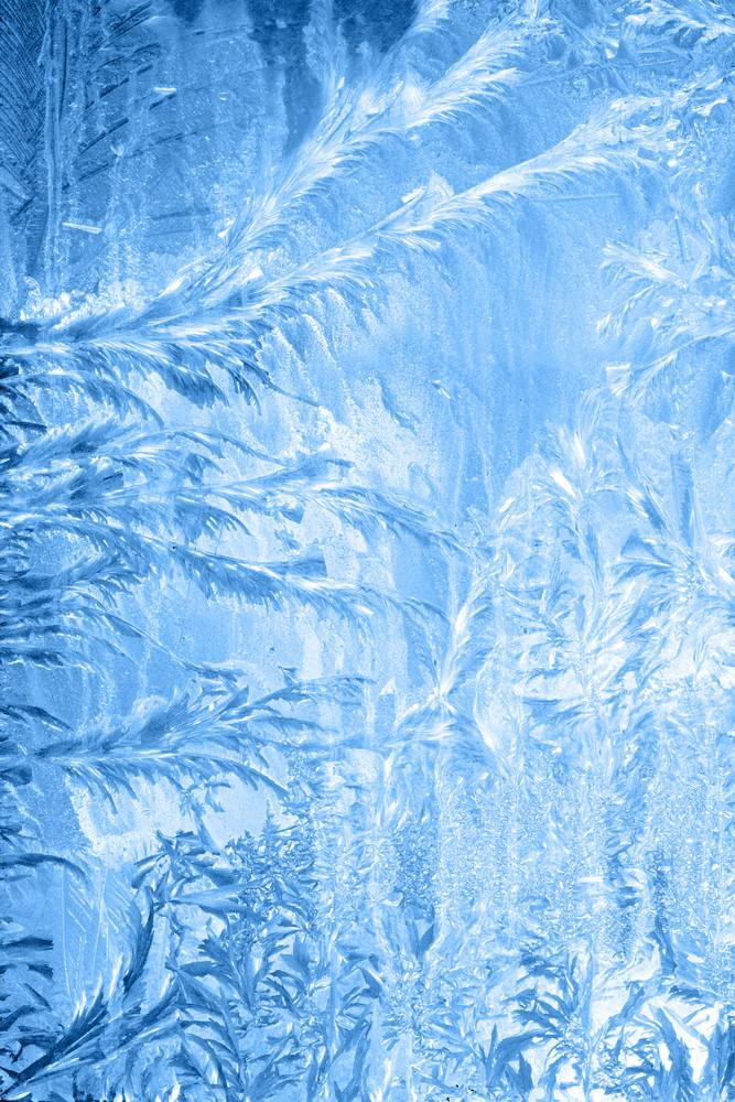 Frosty pattern on window in winter season