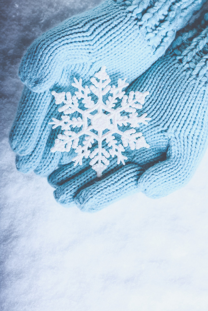 Hands holding snowflake
