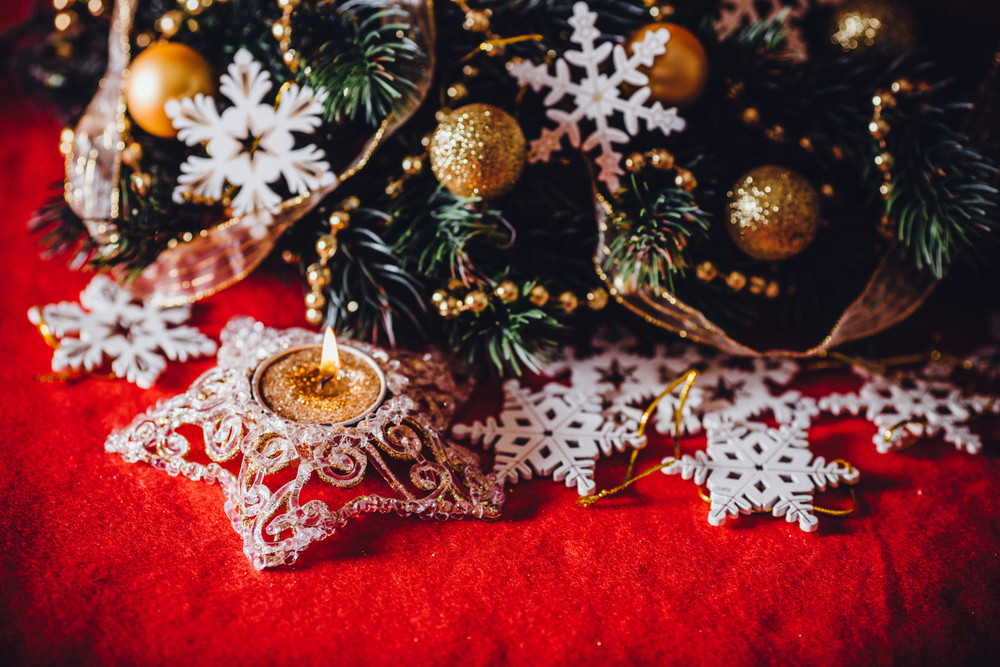 Christmas card with fir tree branch decorated with golden baubles