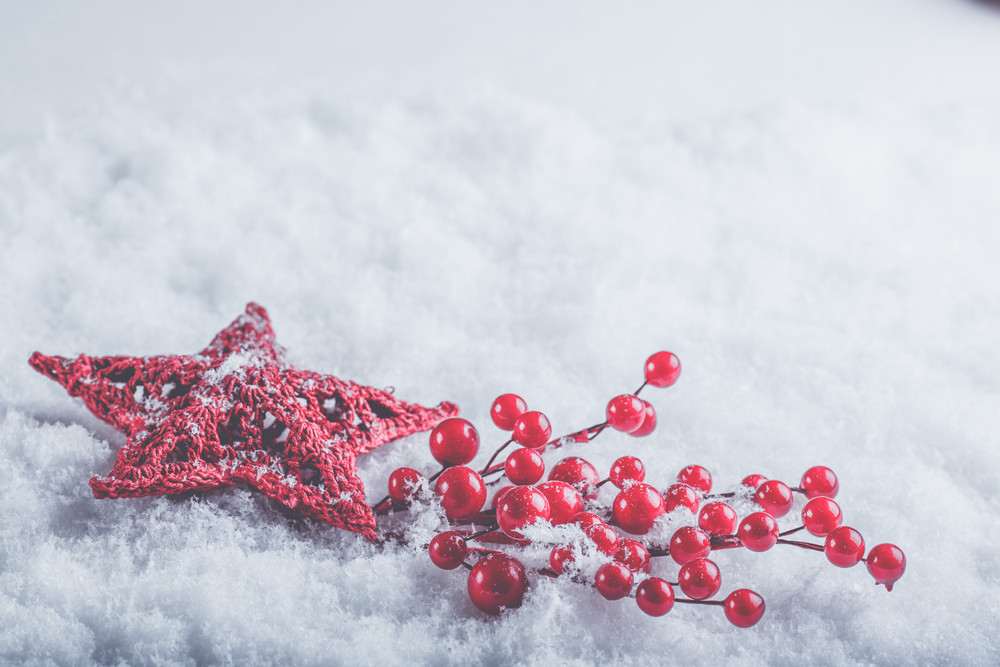 Beautiful romantic vintage red heart with mistletoe berries on a white snow background. Christmas