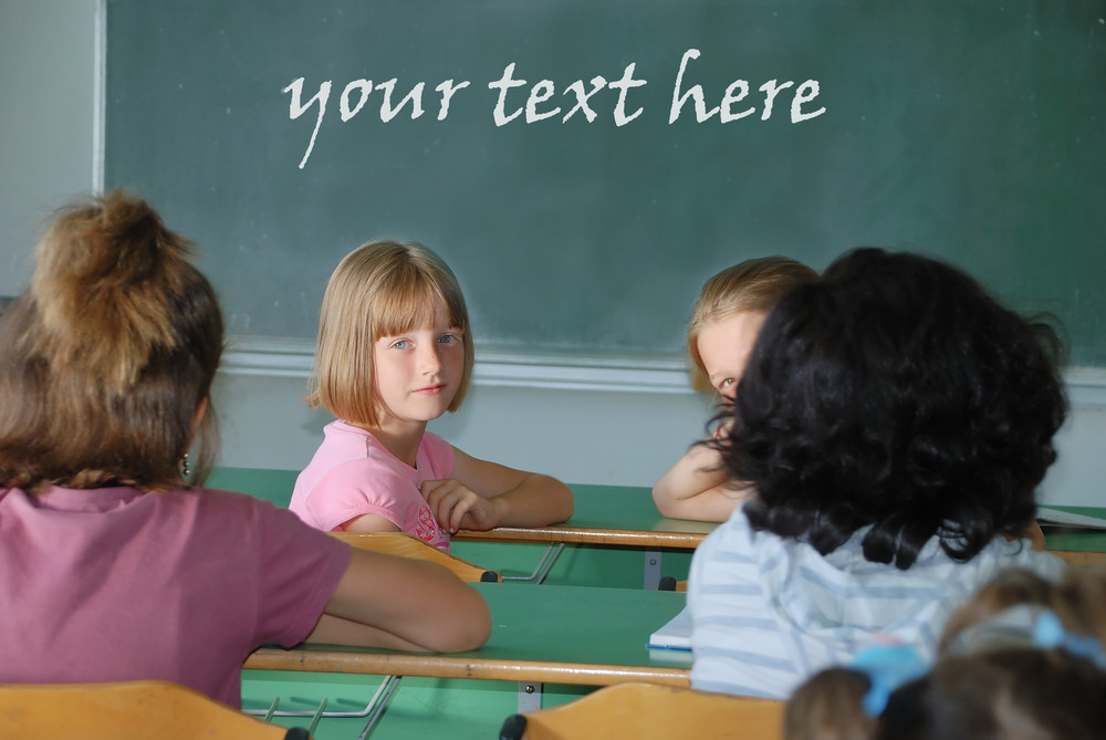 Classroom at school and text on green board