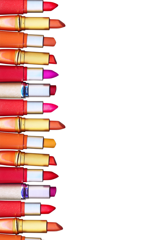 Clipping Path. Row Of Colorful Lipsticks Over White Background