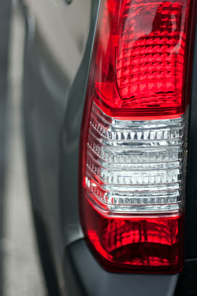 Close up detail of a red automotive tail or brake light.  Shallow depth of field.