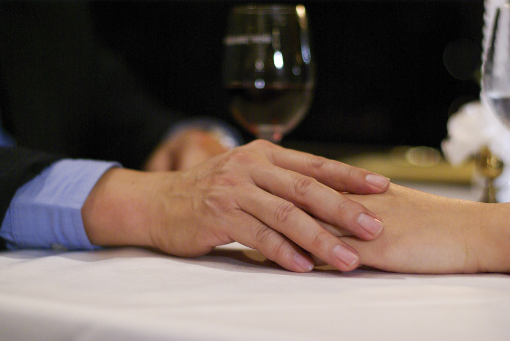 Close up mate lover hand on table in luxury restaurant