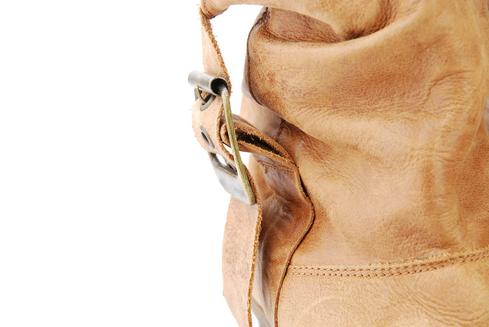 Close-up Of A Women Leather Brown Boot On White
