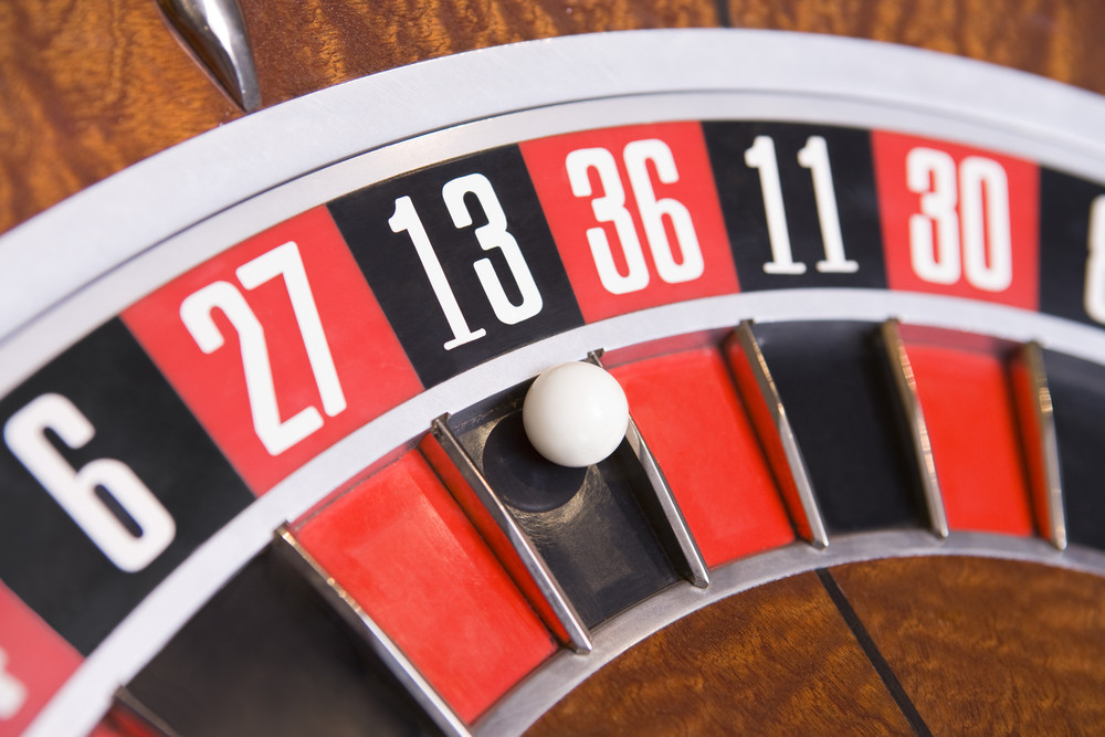 Close up of ball on roulette wheel in number thirteen