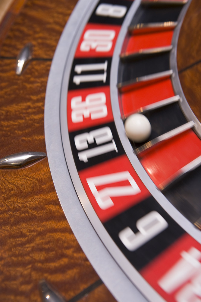 Close up of spinning roulette wheel with ball in number thirteen
