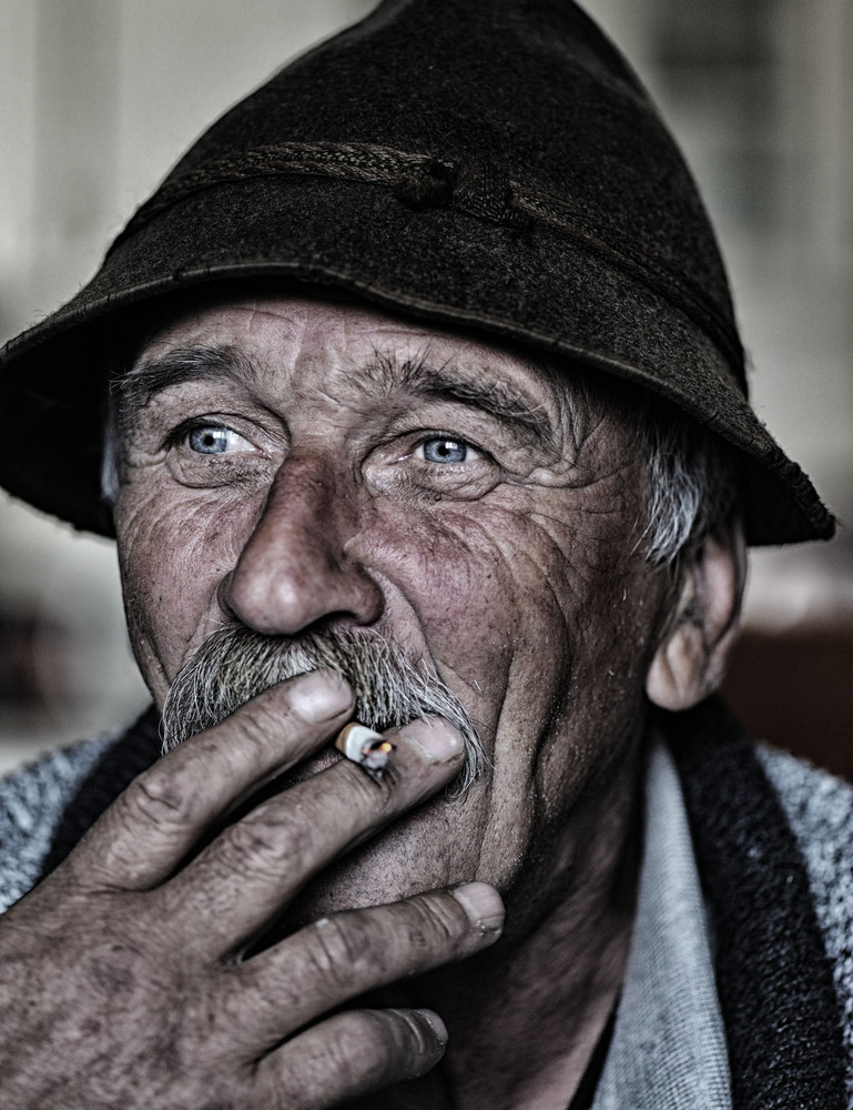Closeup Artistic Photo of Aged Man With  Grey Mustache Smoking Cigarette