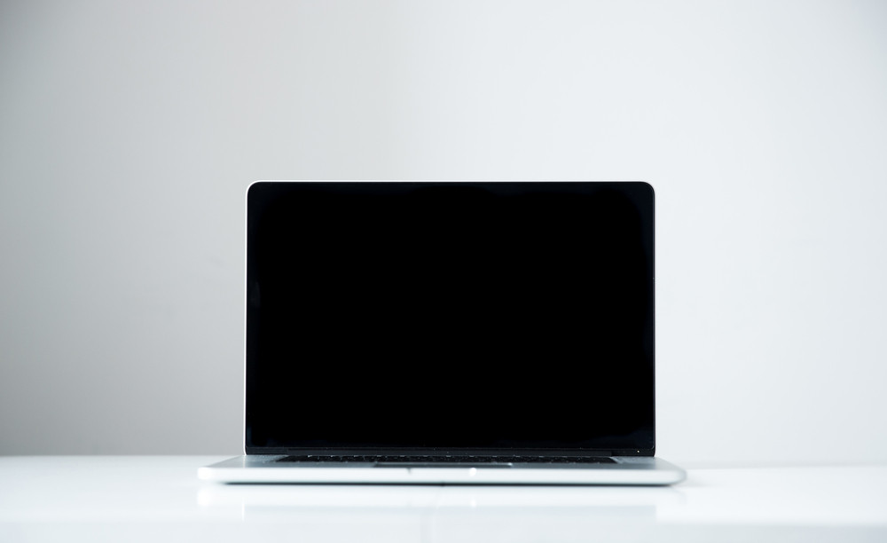 Closeup image of a laptop with blank screen on the table