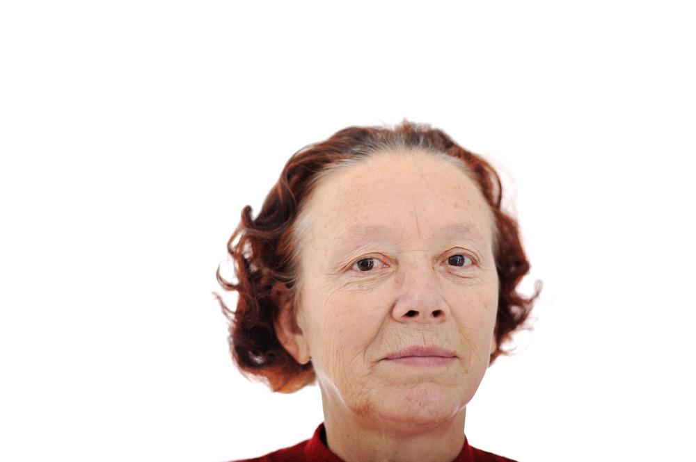 Closeup image of a smiling senior woman