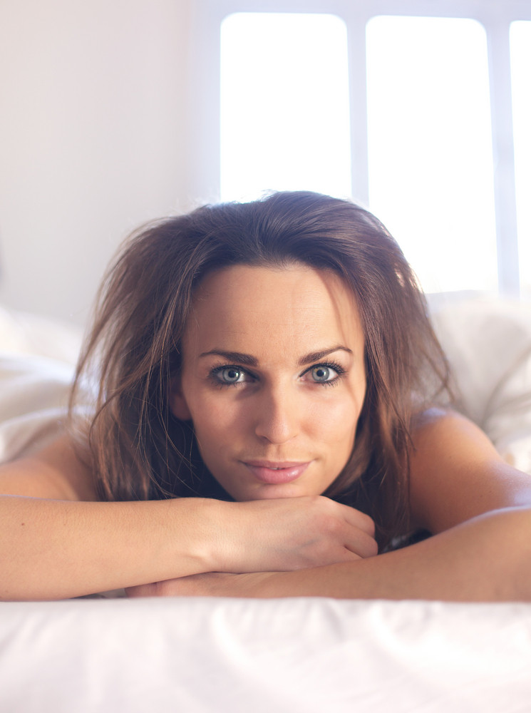 Closeup of a woman with messy bedroom hair looking at you