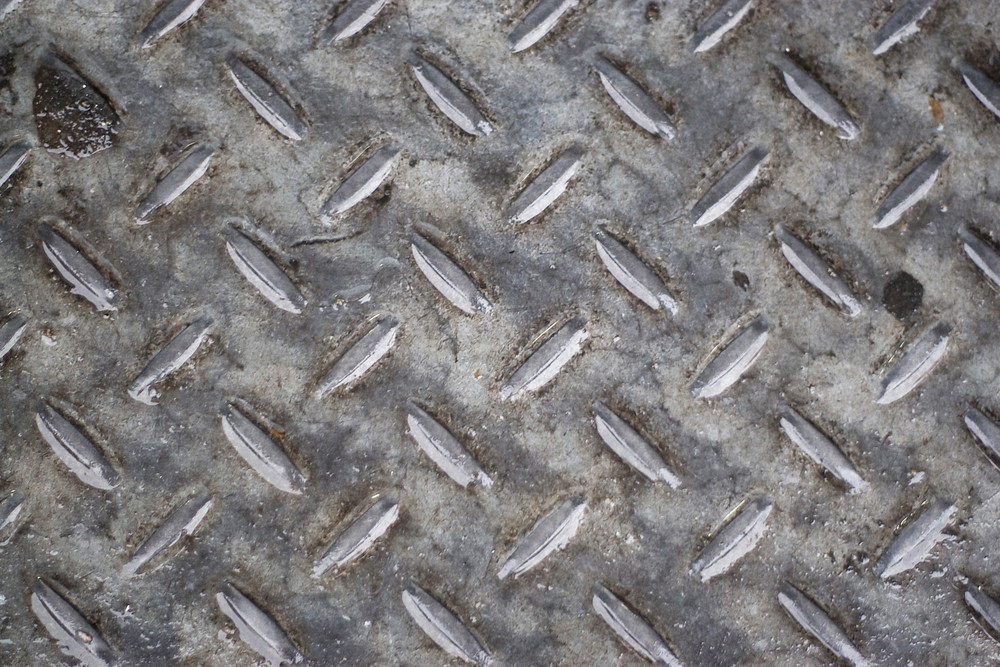 Closeup of real diamond plate material - this is a photo not an illustration.