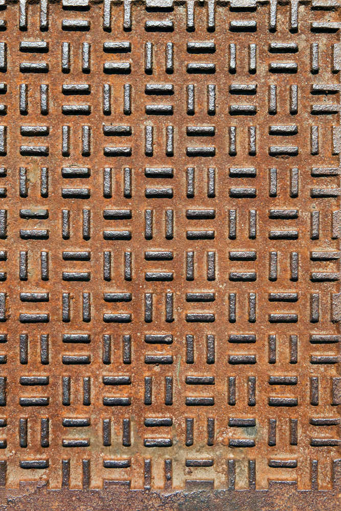 Closeup of real diamond plate metal plate with rust.