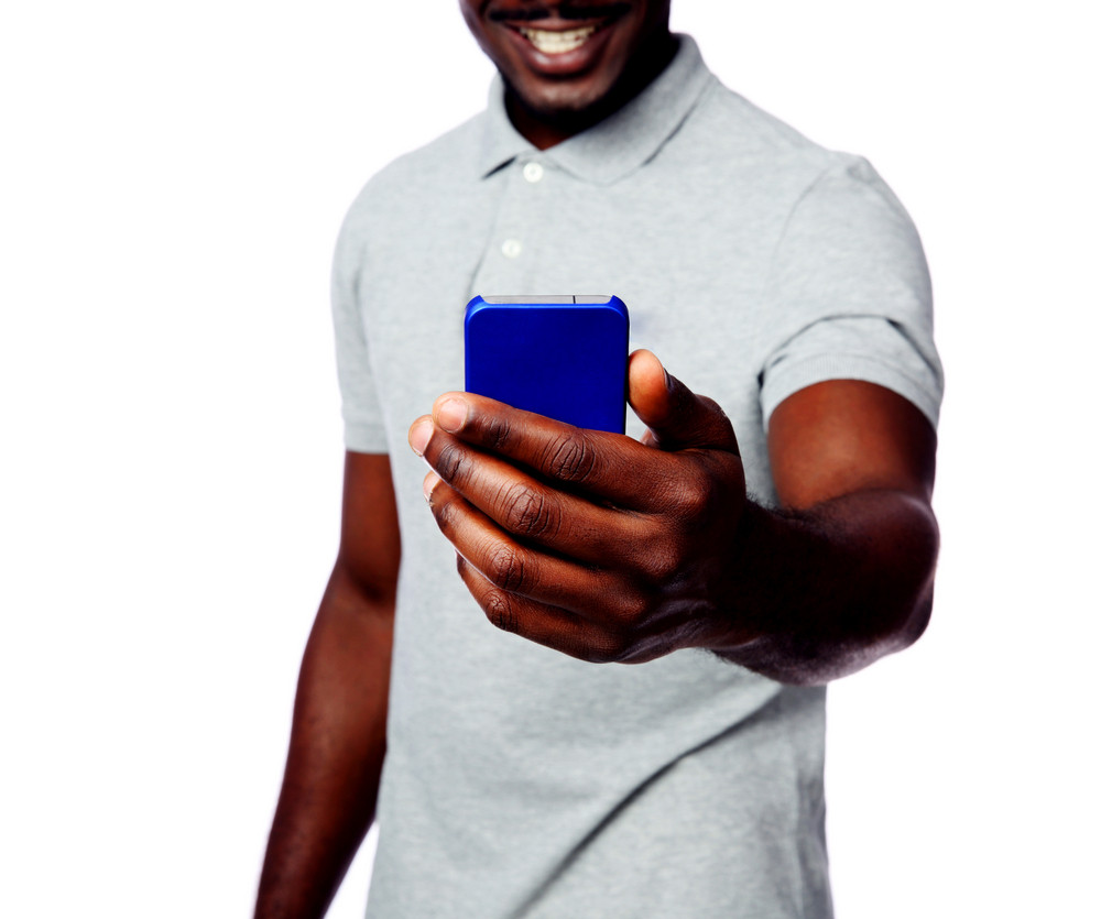 Closeup portrait of a male hands holding smartphone isolated on white background
