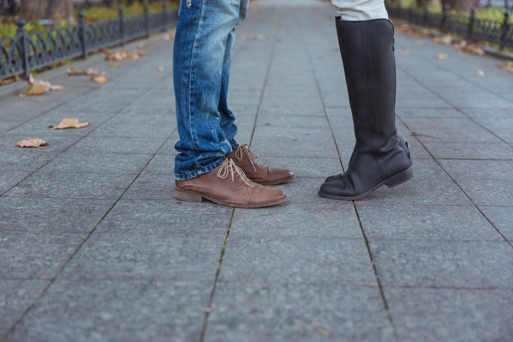 Closeup portrait of a man`s and woman`s legs during a date