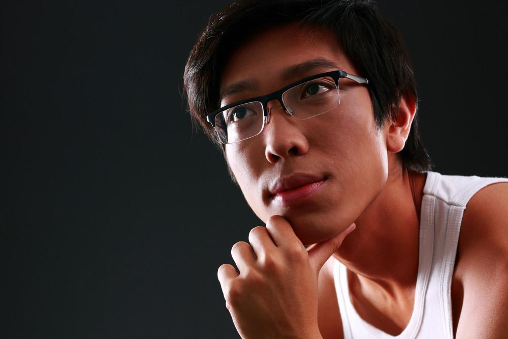 Closeup portrait of a pensive asian man