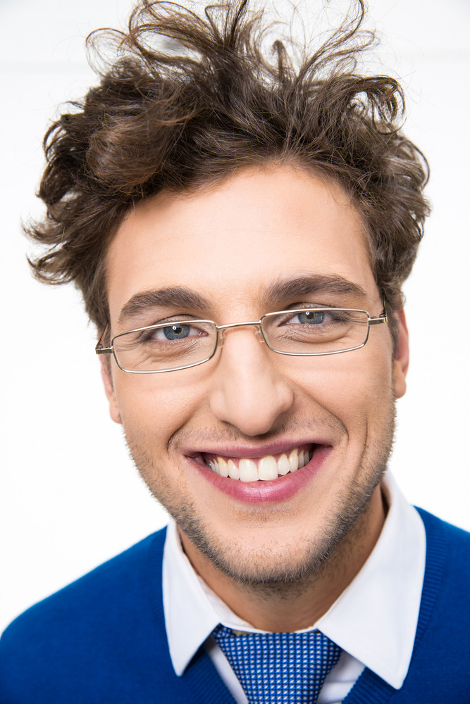 Closeup portrait of a smiling young man in glasses