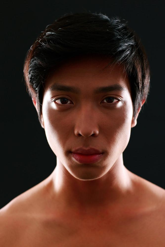Closeup portrait of a young asian man