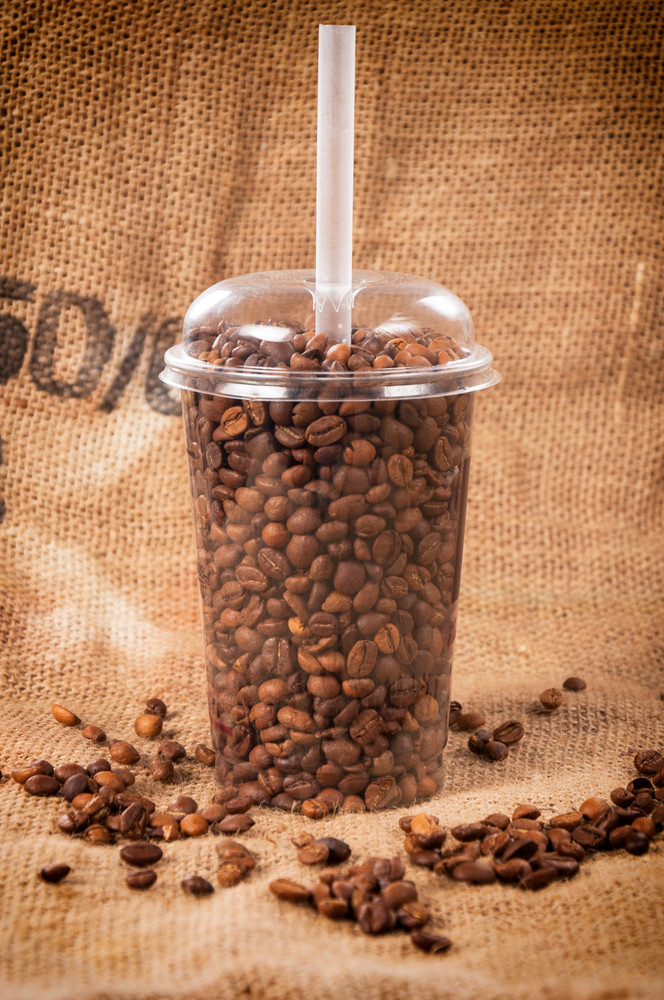 Coffee Beans In Plastic Cup