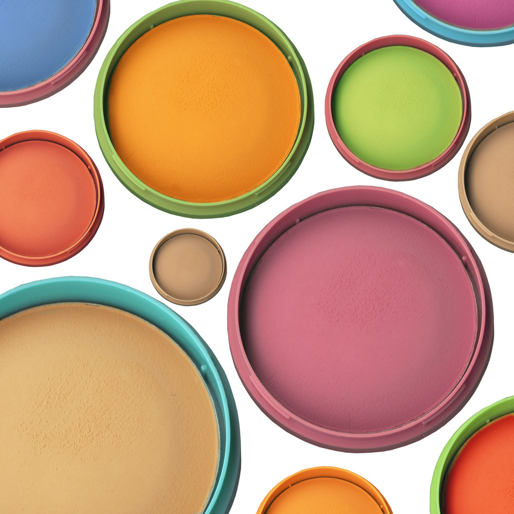 Collection Of Colorfull Eye Shadows And A Face Powder Isolated On White