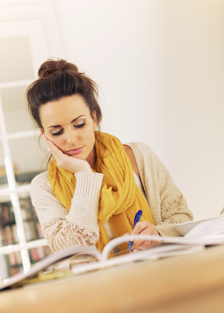 College Student at the Library Reviewing for Her Exams
