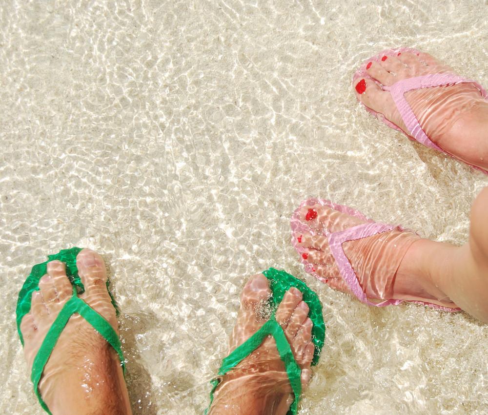 Colorful Flip Flops On Translucent Ocean Water