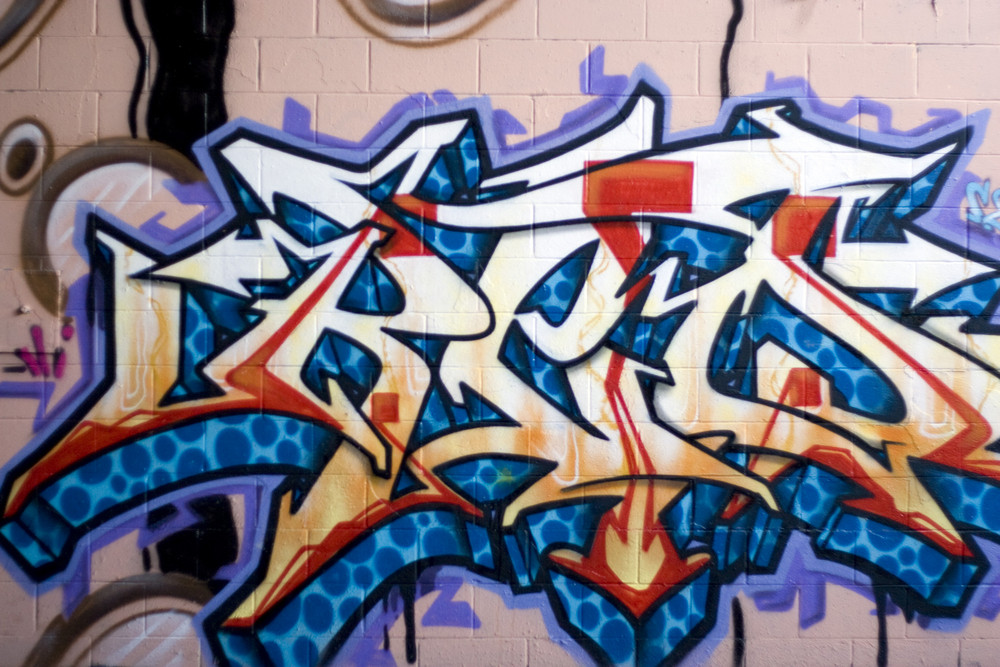 Colorful Graffiti Spray Painted On A Brick Wall Makes A Great