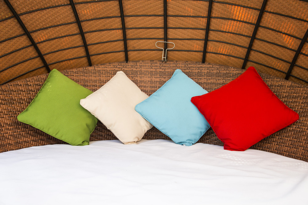 Colorful Pillow on hotel bed with space for text