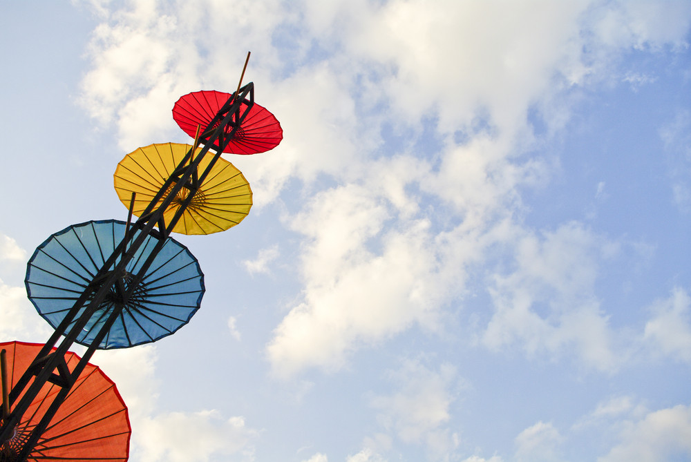Colorful umbrella on blue sky