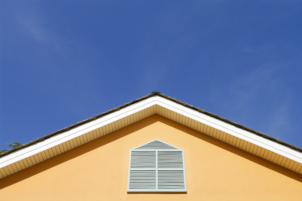 Colorful vintage house roof. Architectural detail.