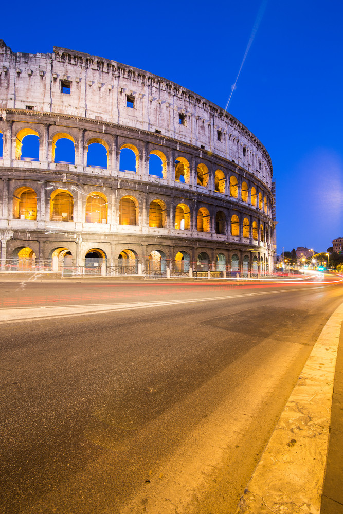 Colosseum in Rome with car lighting, Italy