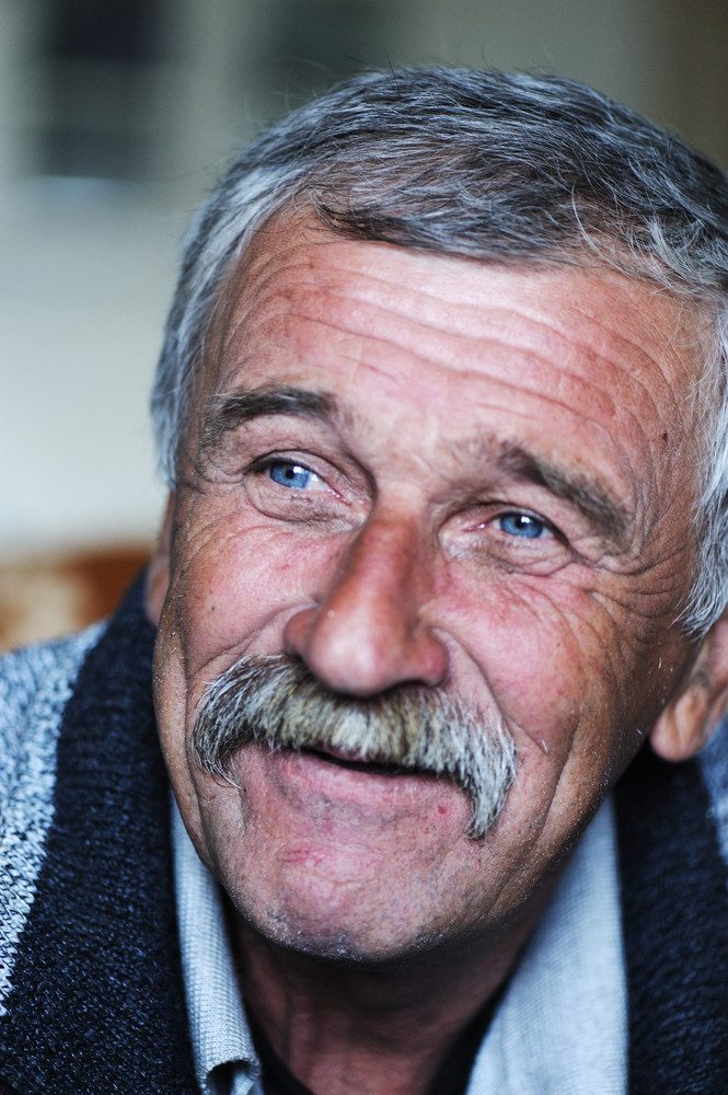 Common elderly positive man with mustache