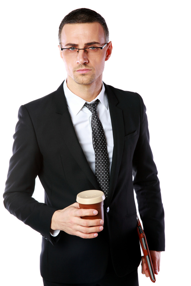 Confident businessman in glasses standing with cup of coffee and tablet computer on white background