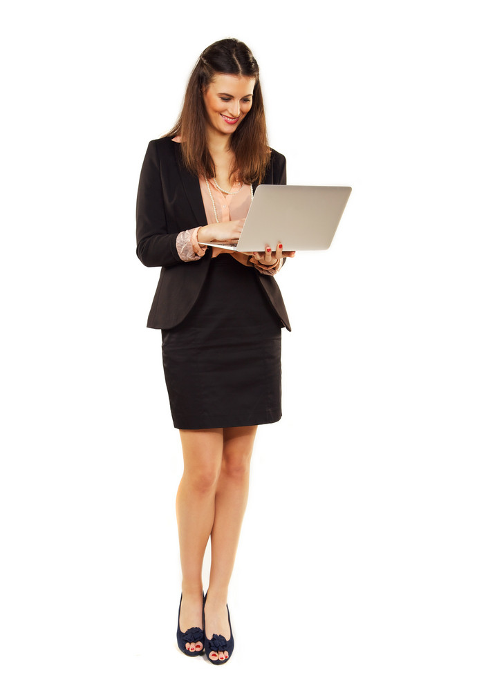 Corporate woman against white background using laptop