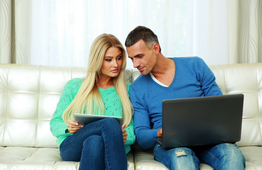 Couple looking at devices