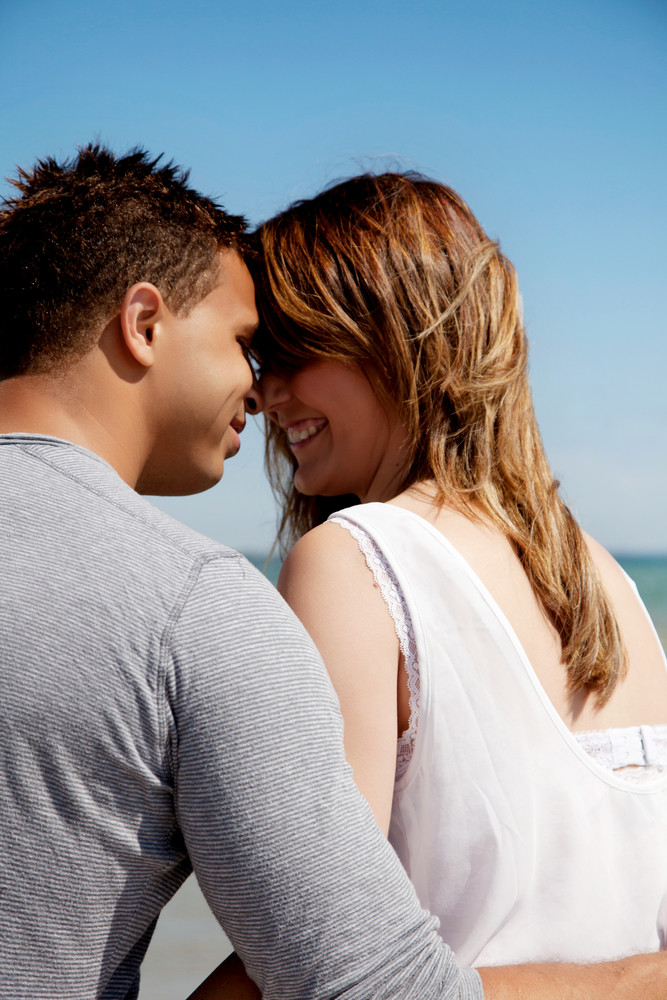Couple looking at each other's eyes against blue background
