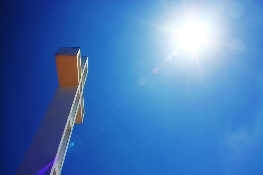 Cross In Sun Rays