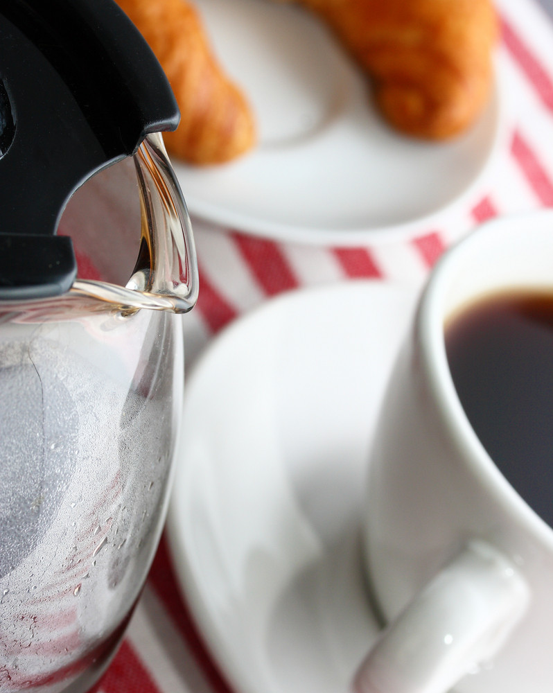 Cup Of Freshly Brewed Coffee With A Croissant