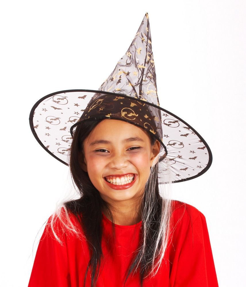 Cute Girl Dressed As A Witch