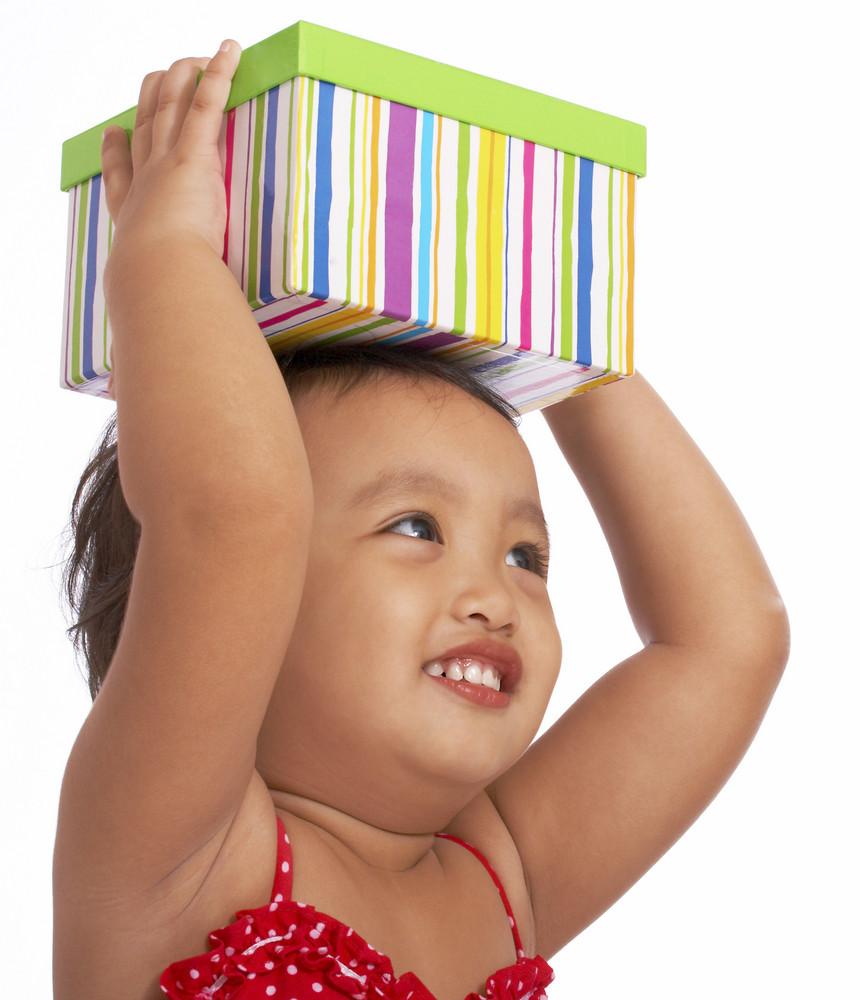 Cute Little Girl Holding A Gift