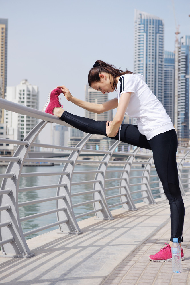 Young Beautiful  Woman Jogging  On Morning