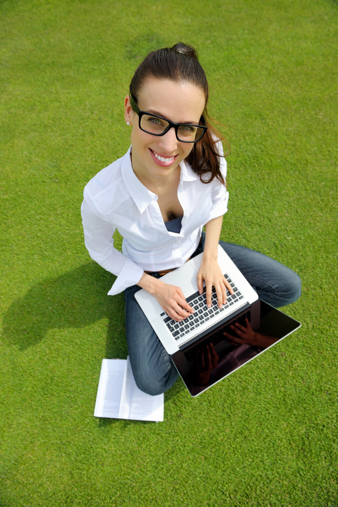 Woman With Laptop In Park