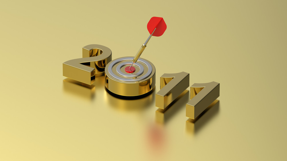 Dart Hitting Target - New Year 2011 Isolated On Gold Background.