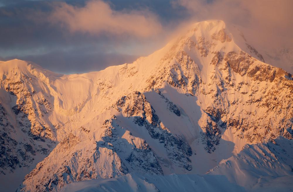 Sunset behind a snowy mountain range